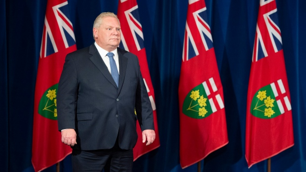Ontario Premier Doug Ford listens as Finance Minister Rod Phillips answers questions at the daily briefing at Queen's Park in Toronto on Thursday, April 9, 2020. THE CANADIAN PRESS/Frank Gunn