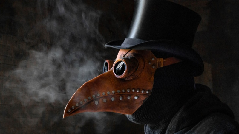 Surgical masks have become synonymous with the COVID-19 pandemic, drawing comparisons to the frightening beaked masks worn by plague doctors in 17th century Europe. But the infamous plague masks were designed based on widespread misconceptions about the deadly disease.(Kuma Kum/Unsplash)