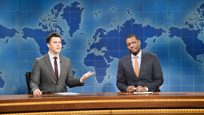 "This Feb. 29, 2020 photo released by NBC shows Colin Jost, left, and Michael Che during the Weekend Update sketch on ""Saturday Night Live"" in New York. (Will Heath/NBC via AP)"