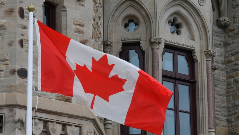 The Canadian flag flies outside the prime minister's office in West Block during a cabinet meeting which the prime minister attended in Ottawa, Wednesday, April 8, 2020. THE CANADIAN PRESS/Adrian Wyld