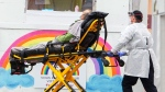 A patient is brought to the emergency department of the St. Eustache hospital Wednesday April 8, 2020 in St. Eustache, Que. THE CANADIAN PRESS/Ryan Remiorz