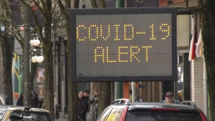 A COVID-19 alert sign is seen on Vancouver's Downtown Eastside in this undated file photo.