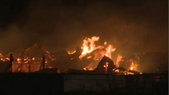 Fire tears through a barn near Alma.