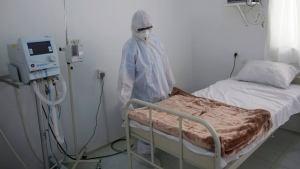 In this, Sunday, March 15, 2020 file photo, a medical staff member works on setting up an isolation room at a coronavirus quarantine ward at a hospital in Sanaa, Yemen. In conflict zones across the Middle East, the specter of the coronavirus looms large. Authorities in Yemen, Libya, Syria, Afghanistan and the Gaza Strip warn that health care systems gutted by years of war and unrest have left millions of people doubly vulnerable to the pandemic. For most people, the virus causes only mild or moderate symptoms. For some it can cause more severe illness. (AP Photo/Hani Mohammed, File)