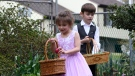 In this Wednesday, April 8, 2020, photo Evelynn Rothenberg, 5, left, and her brother Jack Rothenberg, 6, right, hunt for chocolate Easter eggs in the backyard of their grandmother's home in Glen Burnie, Md. The Rothenberg, who live right next door to their grandmother Antoinette Rothenberg, are all self isolating together because of the coronavirus pandemic and are able to participate in their traditional Easter activities of coloring eggs, an egg tapping battle, and an Easter egg hunt. (AP Photo/Susan Walsh)