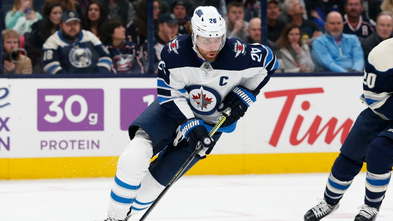 FILE - In this Jan. 22, 2020, file photo, Winnipeg Jets' Blake Wheeler plays against the Columbus Blue Jackets during an NHL hockey game in Columbus, Ohio. (AP Photo/Jay LaPrete, File)