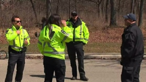 City of Toronto bylaw officers are seen in Woodbine Park on April 10, 2020. (CP24)