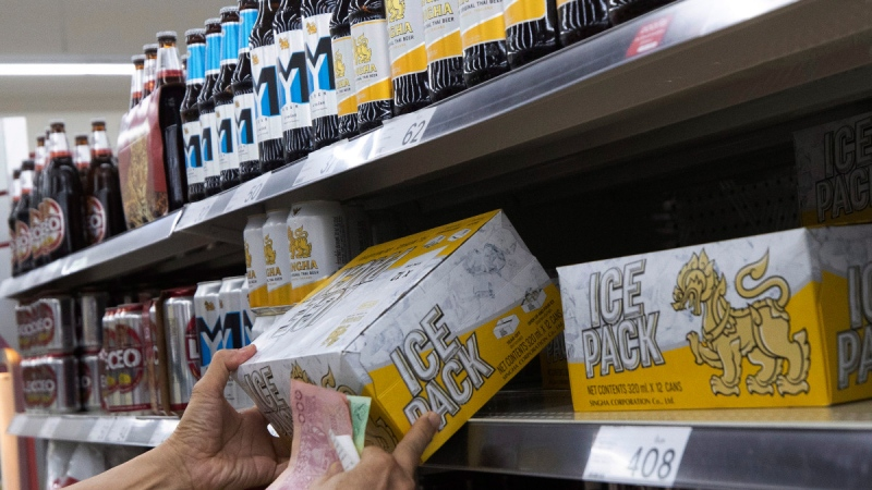 Shopping for beer at a superstore in Bangkok, Thailand, on April 9, 2020. (Sakchai Lalit / AP)