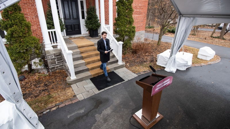 Prime Minister Justin Trudeau arrives for his daily press conference on the COVID-19 pandemic outside of his residence at Rideau Cottage in Ottawa, on Sunday, April 5, 2020. THE CANADIAN PRESS/Justin Tang