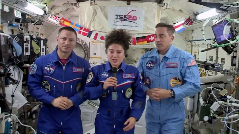 In this image from video made available by NASA, U.S. astronaut Jessica Meir speaks, accompanied by Andrew Morgan and Chris Cassidy, during a news conference held by the American members of the International Space Station on Friday, April 10, 2020. (NASA via AP)