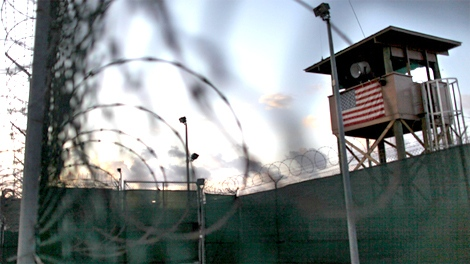 n this photo taken Wednesday, May 13, 2009, and reviewed by the U.S. military, the sun rises over the detention facility at Guantanamo Bay U.S. Naval Base, in Cuba. (AP / Brennan Linsley)