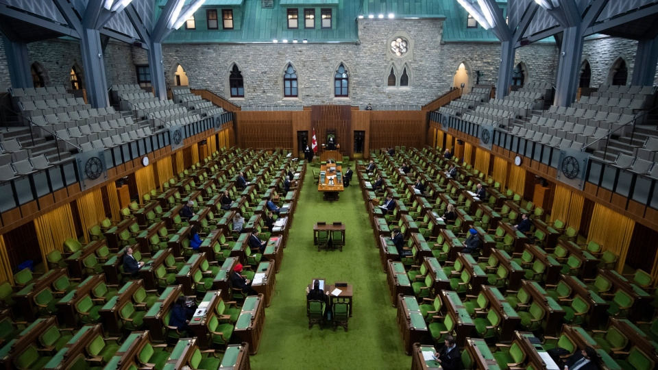 Members of Parliament, attending in limited numbers and seated apart to practice physical distancing, wait for proceedings to begin in the House of Commons on Parliament Hill in Ottawa, as Parliament was recalled for the consideration of measures related to the COVID-19 pandemic, on Saturday, April 11, 2020. THE CANADIAN PRESS/Justin Tang