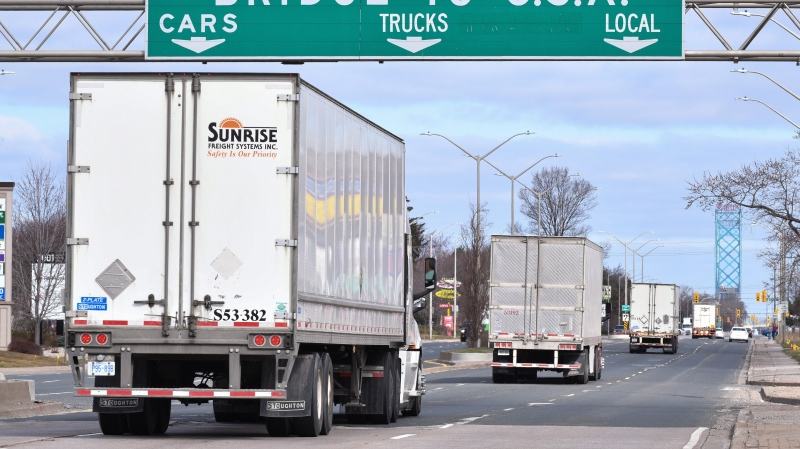 Transport trucks approach the Canada/USA border crossing in Windsor, Ont. on Saturday, March 21, 2020. Rob Gurdebeke / THE CANADIAN PRESS
