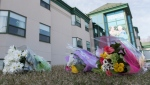 Flowers are shown outside Maison Herron, a long term care home in the Montreal suburb of Dorval, Sunday, April 12, 2020, as COVID-19 cases rise in Canada and around the world. THE CANADIAN PRESS/Graham Hughes