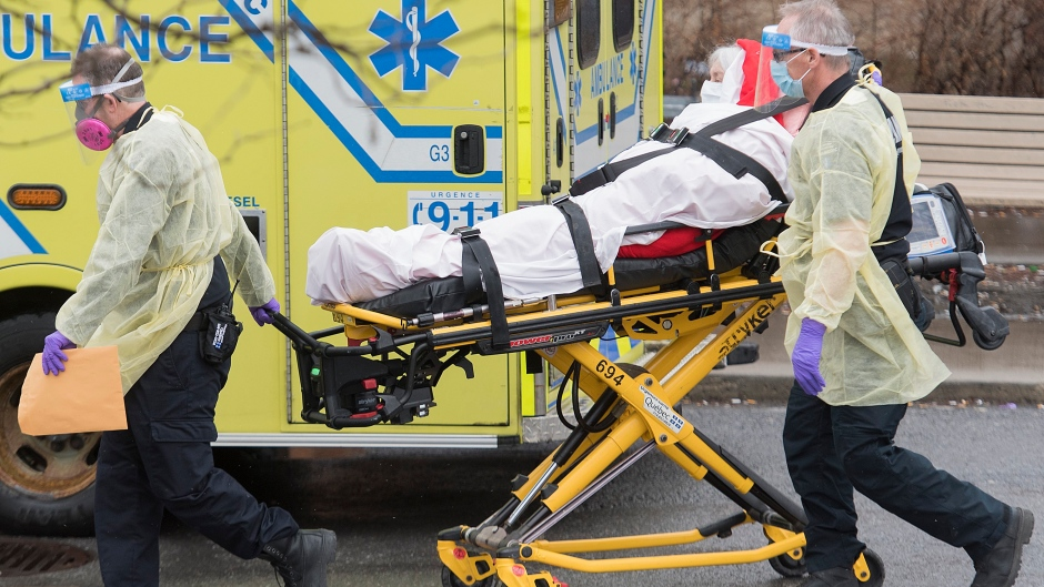 Paramedics take a patient from an ambulance at the Verdun Hospital in Montreal, Friday, April 10, 2020. THE CANADIAN PRESS/Graham Hughes
