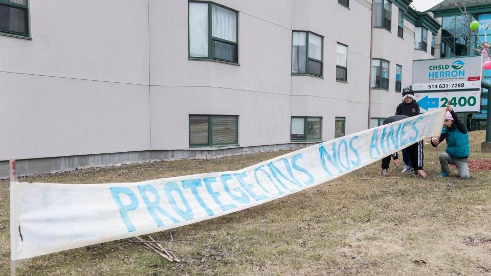 'Protect our Seniors' outside Maison Herron