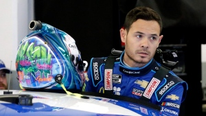 Kyle Larson gets ready to climb into his car to practice for the NASCAR Daytona 500 auto race at Daytona International Speedway, Friday, Feb. 14, 2020, in Daytona Beach, Fla. (AP Photo/Terry Renna)