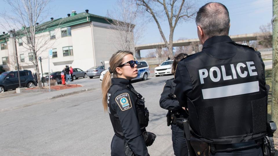 Officers outside Maison Herron