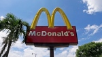 """This June 28, 2016, file photo shows a McDonald's sign in Miami. A few McDonald's workers in Florida are filing a $500 million class action lawsuit against the company, claiming a """"systemic sexual harassment problem"""" at company-owned stores. The lawsuit was filed Monday, April 13, 2020, in federal court in Illinois. (AP Photo/Alan Diaz, File)"""
