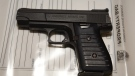 London police provide a photo of a 9 mm handgun they say officers seized in a raid last week.