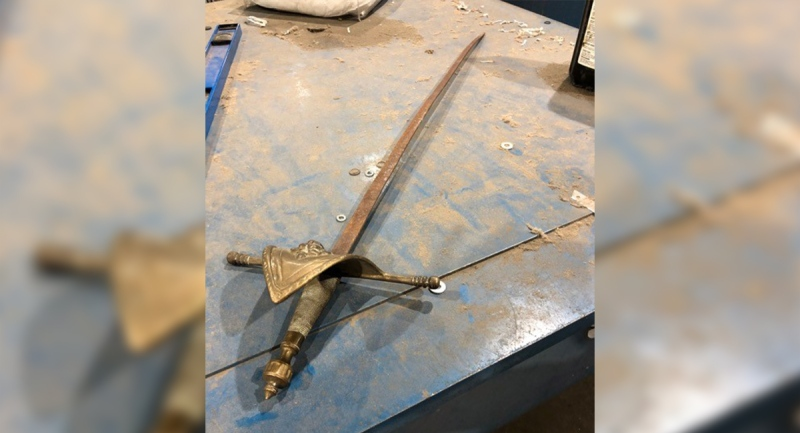 A local recycling company says an employee found this sword in a blue box.  (Facebook / Bluewater Recycling Association)