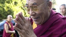 The Dalai Lama arrives at UBC for a panel discussion in Vancouver, B.C. on Sunday, Sept. 27, 2009. (Jonathan Hayward / THE CANADIAN PRESS)