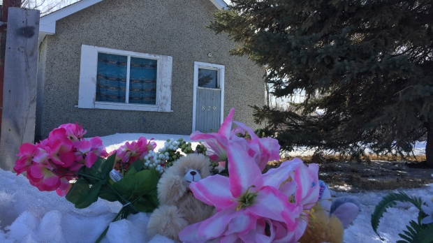 A makeshift memorial in Prince Albert for a three-year-old girl who police believe died by homicide.