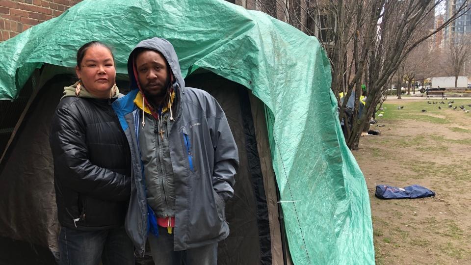 Romeo Pratt and Nikki Renaud stand outside their tent on Sanctuary's property. (Beth Macdonell/CTV News Toronto)