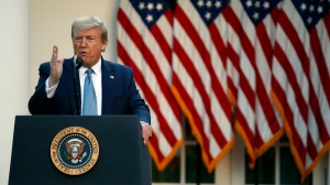 U.S. President Donald Trump speaks about the coronavirus in the Rose Garden of the White House, Wednesday, April 15, 2020, in Washington. (AP Photo/Alex Brandon)