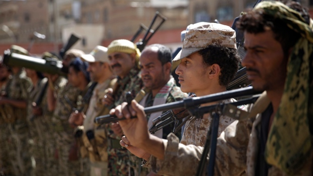 In this Feb. 20, 2020 file photo, Houthi rebel fighters display their weapons during a gathering aimed at mobilizing more fighters for the Iranian-backed Houthi movement, in Sanaa, Yemen. (AP Photo/Hani Mohammed, File)