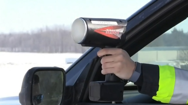 officer holds speed camera