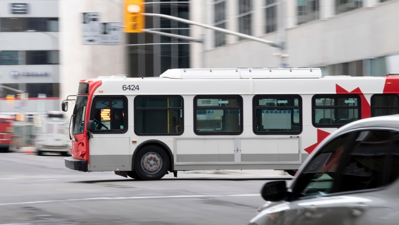An OC Transpo bus rolls through downtown Ottawa, Thursday April 16, 2020. (Adrian Wyld/THE CANADIAN PRESS)