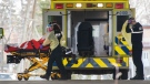 A patient is brought into the emergency unit at Lasalle Hospital Friday April 17, 2020 in Montreal. THE CANADIAN PRESS/Ryan Remiorz