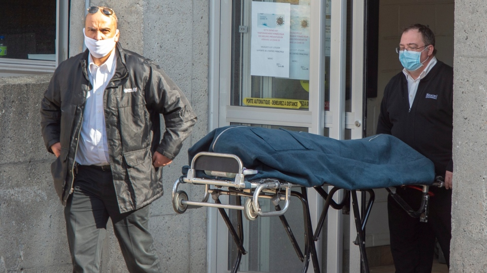 Funeral home workers remove a body from the Centre d'hebergement Sainte-Dorothee Friday April 17, 2020 in Laval Que.. The residence has reported over 100 confirmed cases of COVID-19.THE CANADIAN PRESS/Ryan Remiorz