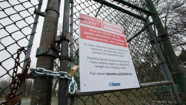 A locked gate is seen at High Park in Toronto on Friday, May 1, 2020. THE CANADIAN PRESS/Frank Gunn