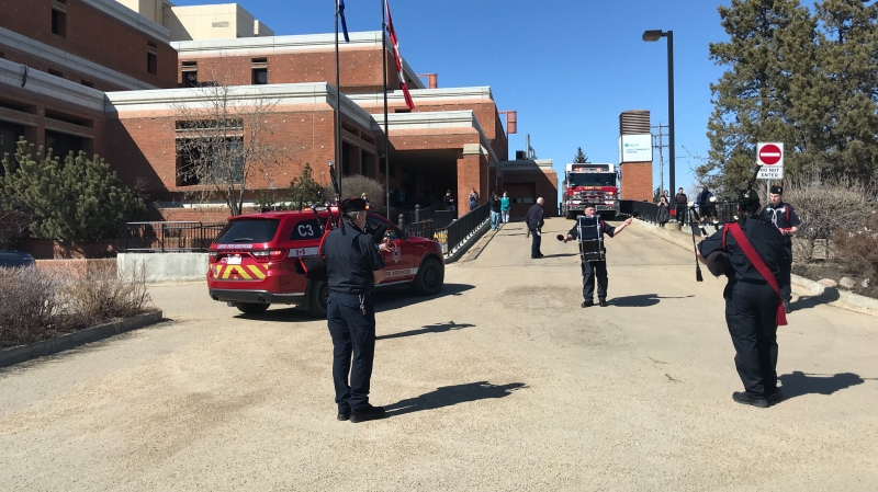 The Leduc Fire Services Pipes and Drums band performed in front of the community hospital on April 18, 2020.