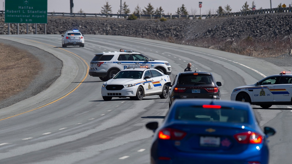 Police block the highway in Enfield, N.S. on Sunday, April 19, 2020. The RCMP have taken Gabriel Wortman, 51, into custody after an incident in Portapique, N.S. where several people were shot. THE CANADIAN PRESS/Andrew Vaughan