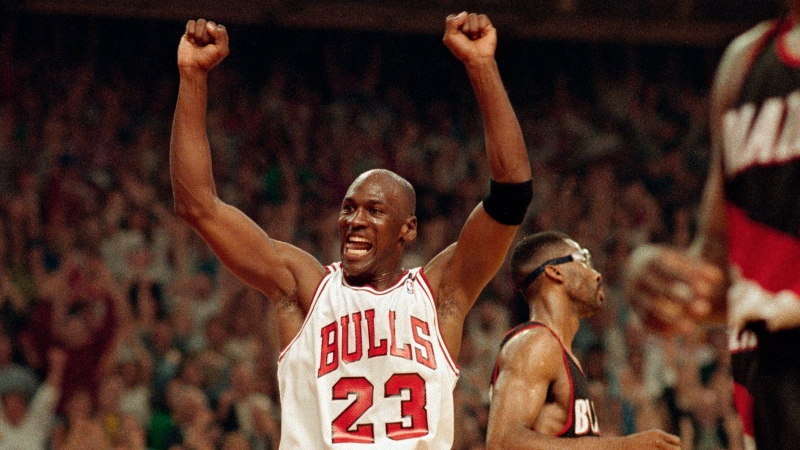 In this June 14, 1992, file photo, Michael Jordan celebrates the Bulls win over the Portland Trail Blazers in the NBA Finals in Chicago. (AP Photo/John Swart, File)