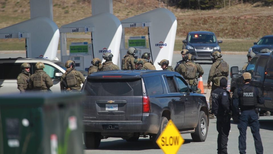 RCMP officers prepare to take Gabriel Wortman into custody at a gas station in Enfield, N.S. on Sunday April 19, 2020. Wortman, who was shot by a Mountie, later died of his wounds. (THE CANADIAN PRESS)