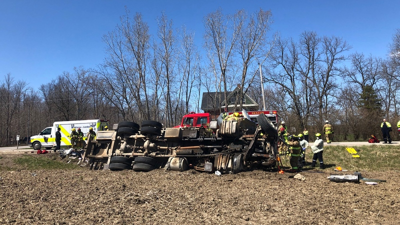 A transport truck flipped after a collision at Vanneck and Ilderton roads in Middlesex Centre, Ont. on Monday, April 20, 2020. (Jordyn Read / CTV London)