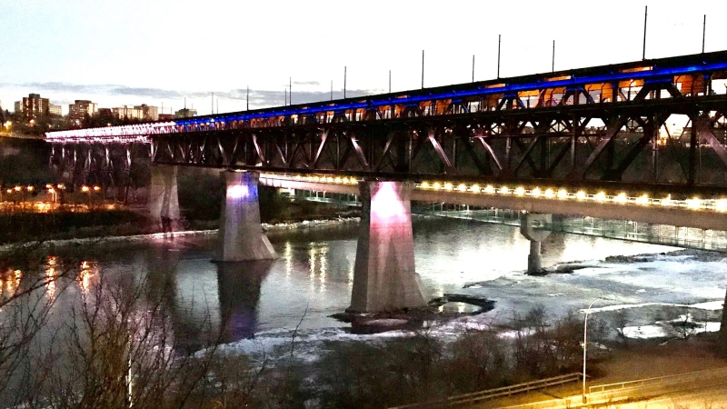 The High Level Bridge was lit in blue and white on April 20, 2020 in a show of solidarity with Nova Scotia. (Sean Amato/CTV News Edmonton)