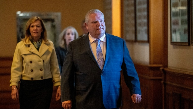 Ontario Premier Doug Ford leads Health Minister Chritine Elliott and Minister of Long Term Care Dr. Merilee Fullerton to the daily briefing at Queen's Park in Toronto on Monday, April 20, 2020. THE CANADIAN PRESS/Frank Gunn