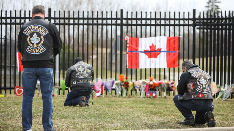 People attend a make-shift memorial dedicated to Constable Heidi Stevenson at RCMP headquarters in Dartmouth, Nova Scotia, Monday, April 20, 2020. THE CANADIAN PRESS/Riley Smith
