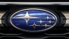 FILE - In this Feb. 14, 2019, file photo the Subaru logo on the front grill of a 2019 Subaru Impreza sedan is displayed at the 2019 Pittsburgh International Auto Show in Pittsburgh. (AP Photo/Gene J. Puskar, File)