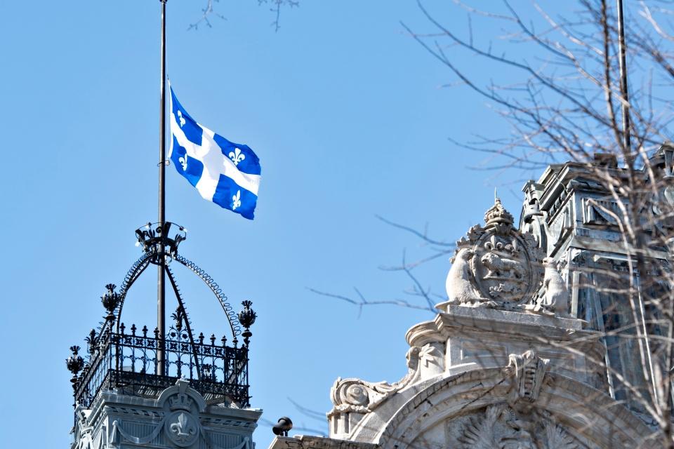 FILE PHOTO: The Quebec flag flies at half-mast at the legislature in Quebec City. THE CANADIAN PRESS
