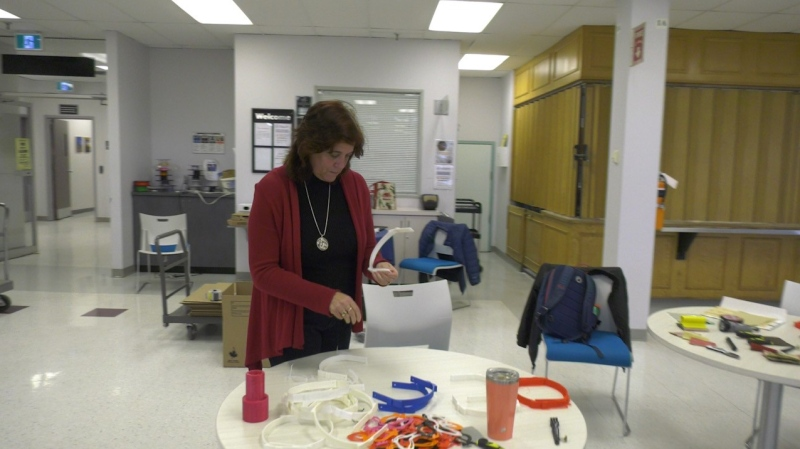 Ottawa Catholic School Board Superintendent Debbie Frendo helps prepare finished headbands for delivery. Ottawa, ON. April 21, 2020. (Tyler Fleming / CTV News Ottawa)