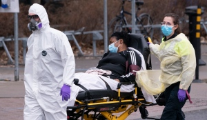 Paramedics bring a patient to Verdun Hospital in Montreal, on Tuesday, April 21, 2020. THE CANADIAN PRESS/Paul Chiasson