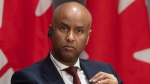 Families, Children and Social Development Minister Ahmed Hussen listens to a question during a news conference Tuesday April 21, 2020 in Ottawa. THE CANADIAN PRESS/Adrian Wyld