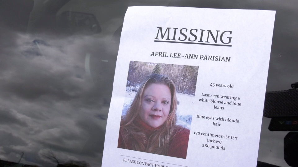 A missing person's poster for April Lee-Ann Parisian is seen on a window on April 21, 2020.