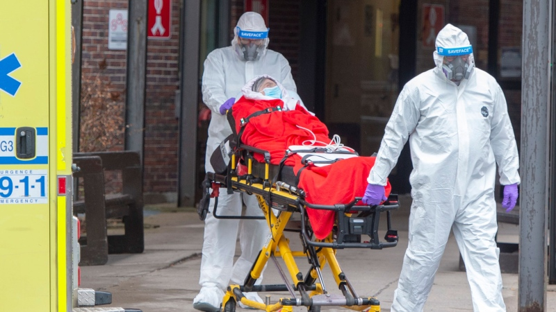 A resident is transported from the CHSLD Lasalle seniors residence Tuesday April 21, 2020 in Montreal.THE CANADIAN PRESS/Ryan Remiorz